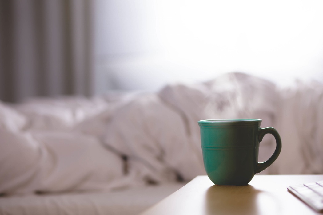Aspirational image of a cup of tea in bed (image by David Mao)